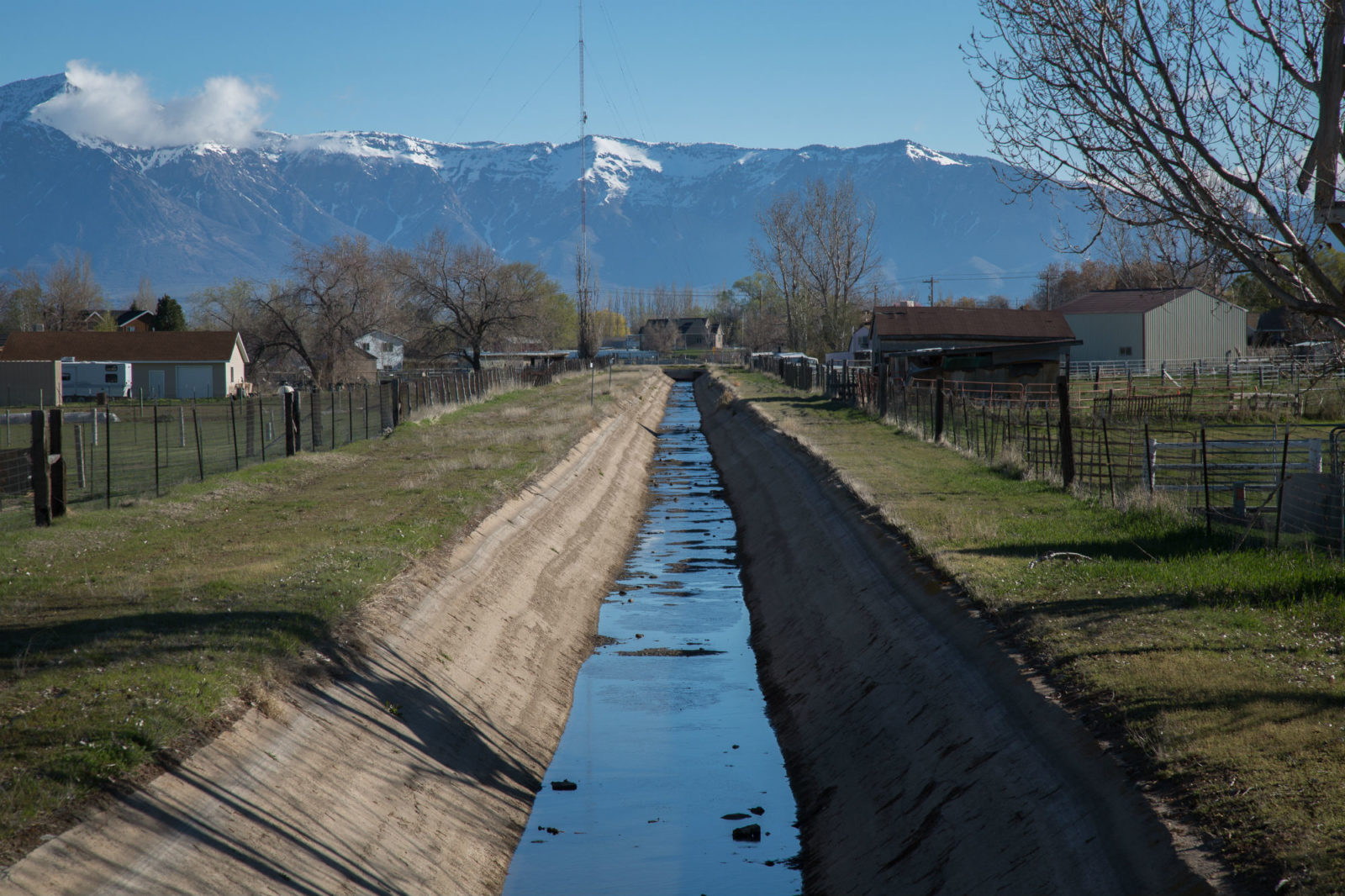 A Hooper irrigation canal weaves through western Weber County on Tuesday, April 4, 2017. (BENJAMIN ZACK/Standard-Examiner)